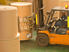 Forklift worker in paper warehouse [photo]